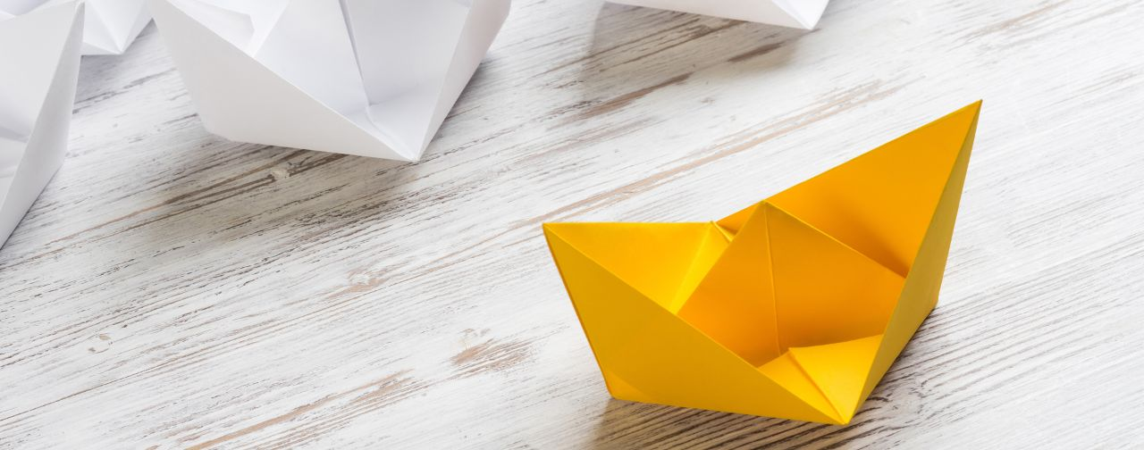 Yellow Paper Shown as Leader Among Other White Boats