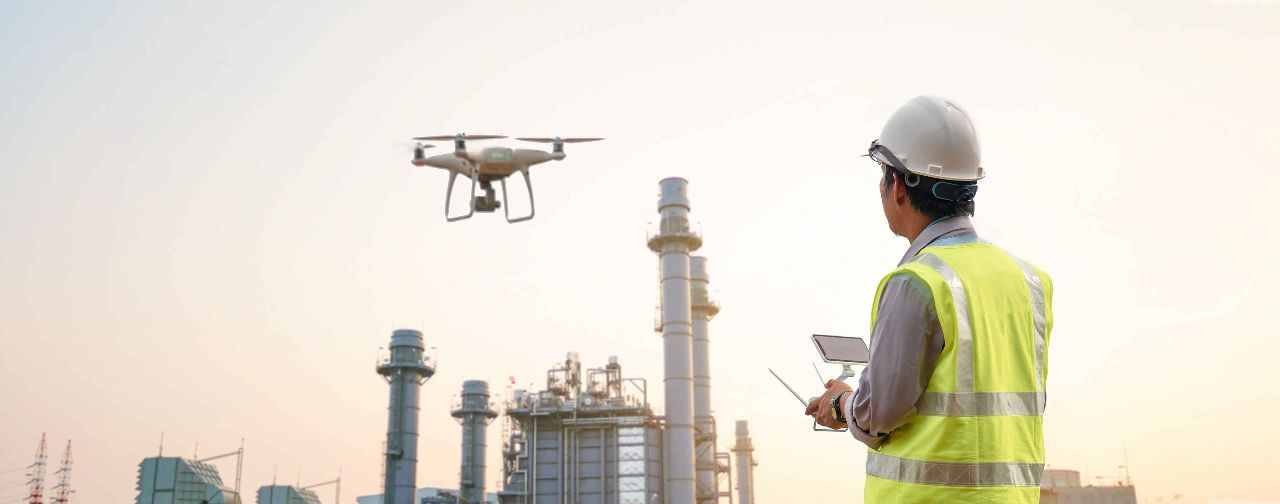 Drone Operator inspecting construction building