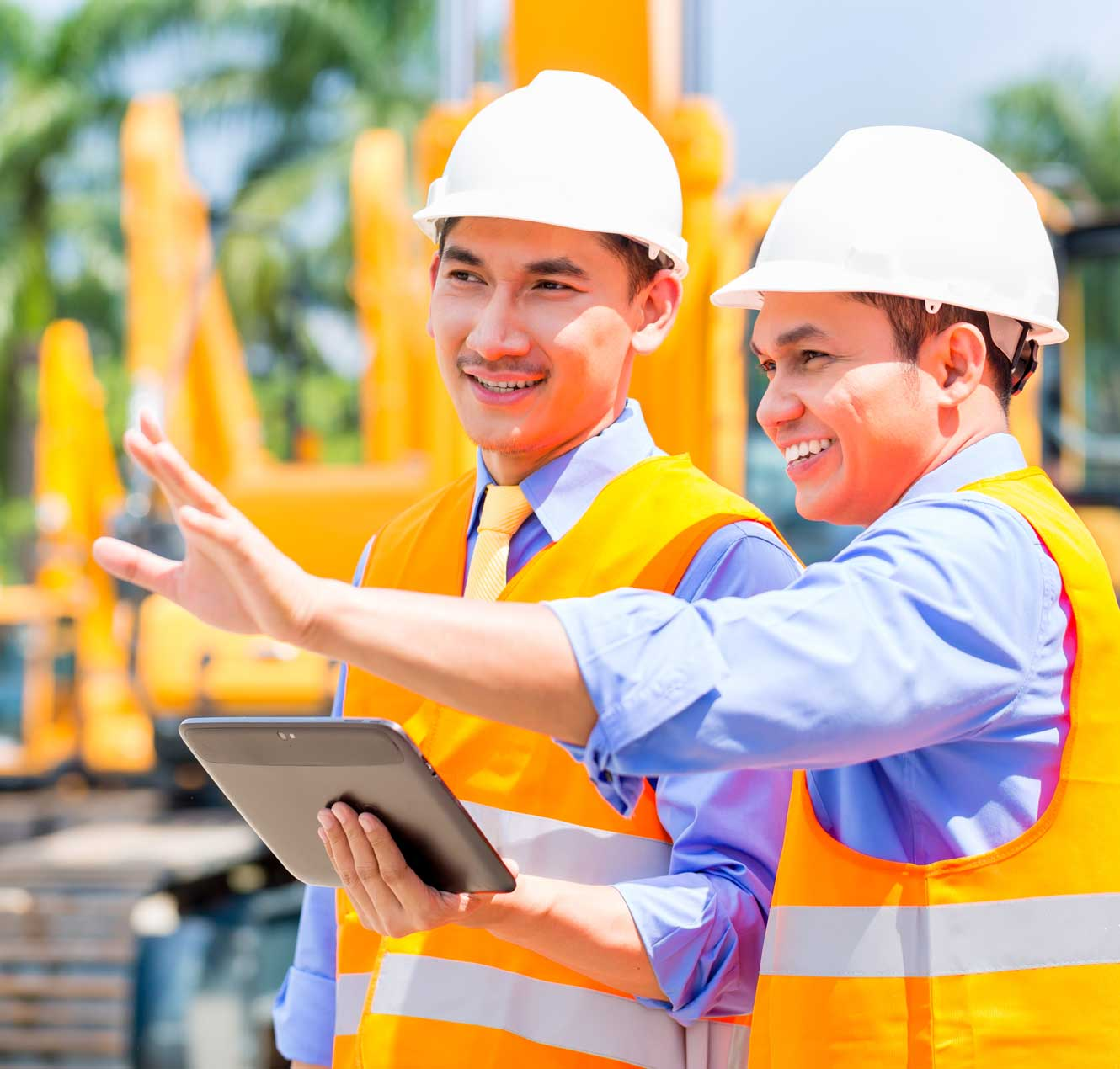 Engineer monitoring construction machinery at construction site or mining company