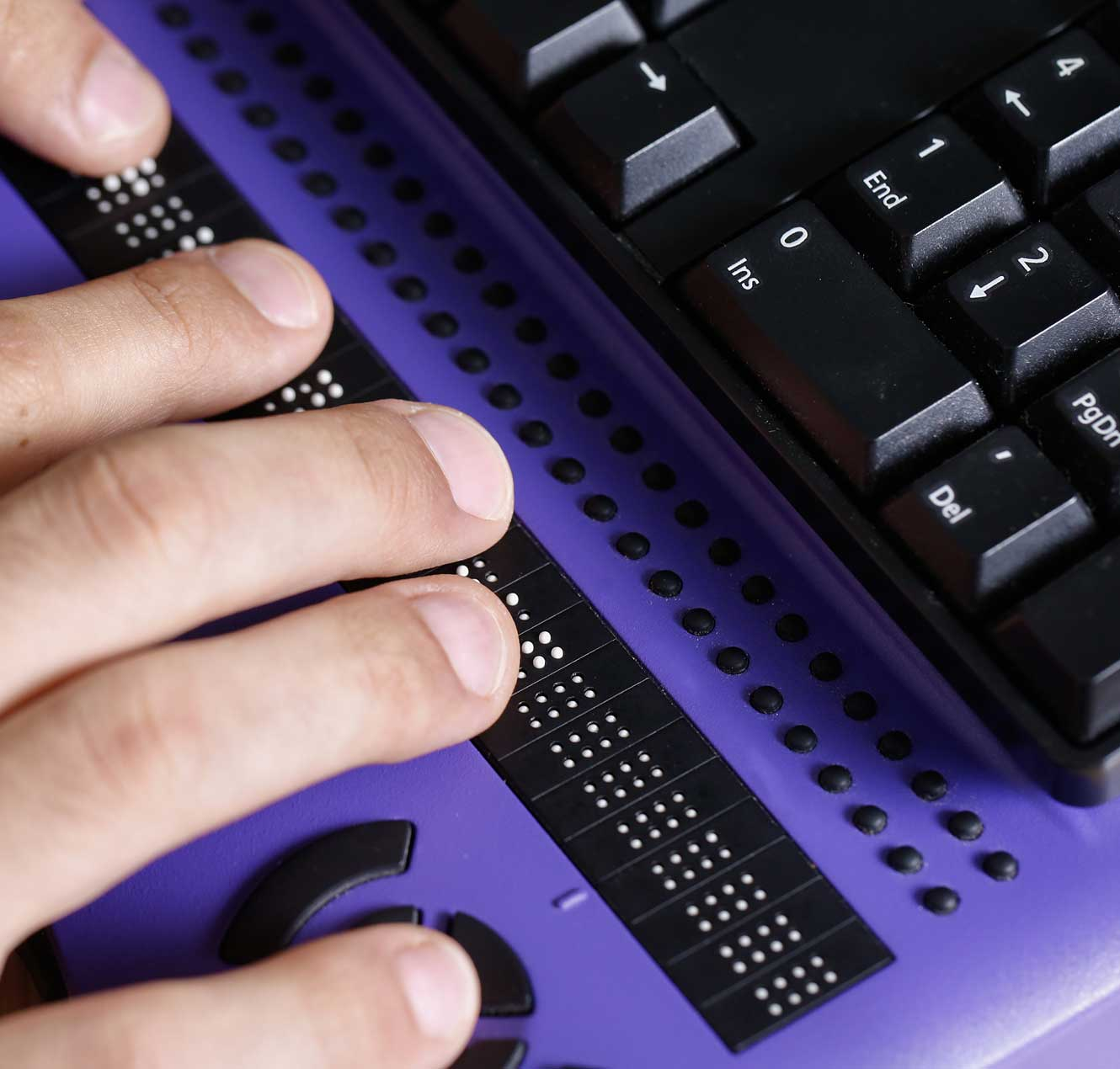 A person using a braille integrated keyboard