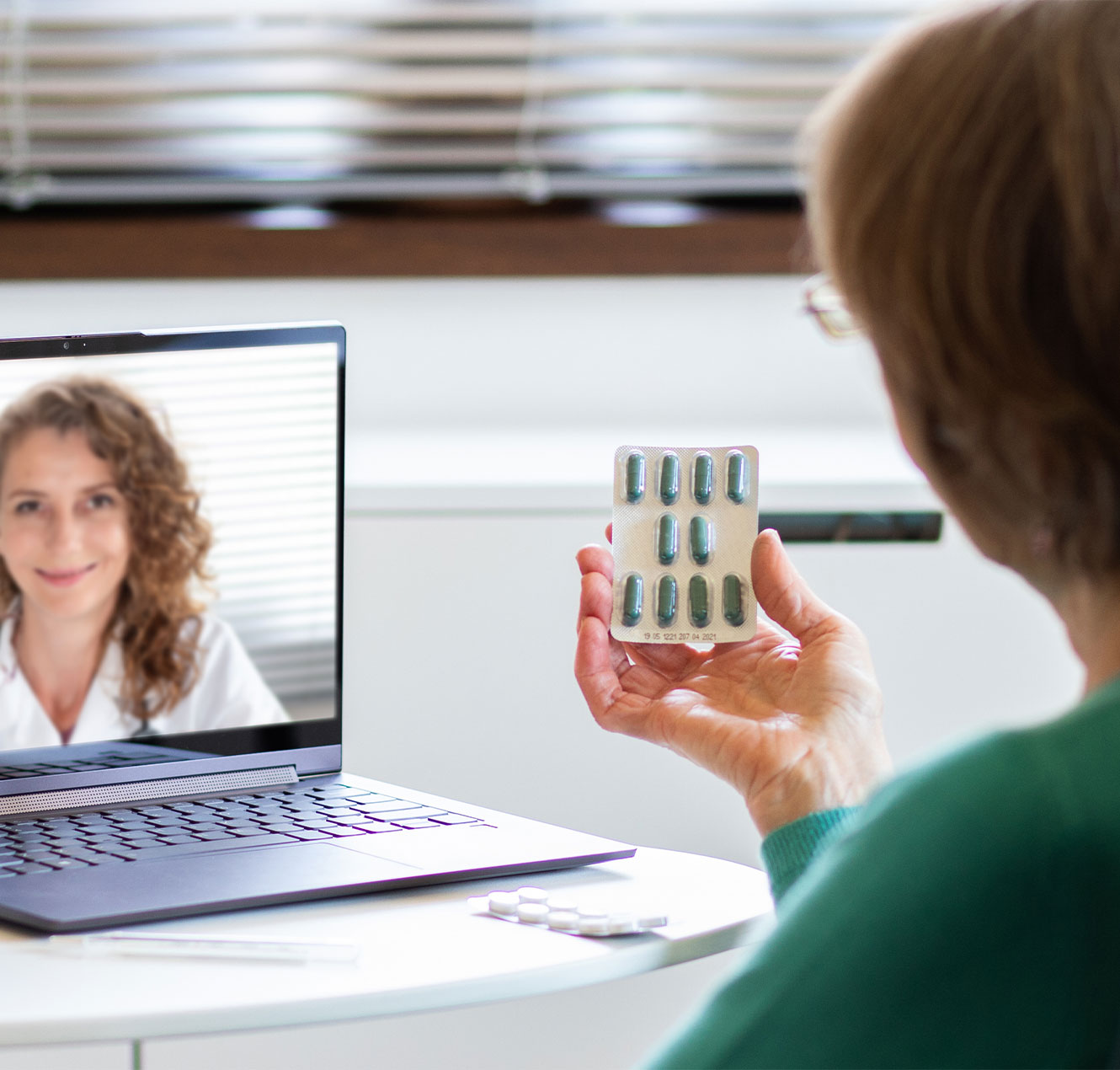 Patients speaking to doctor online to discuss about medication