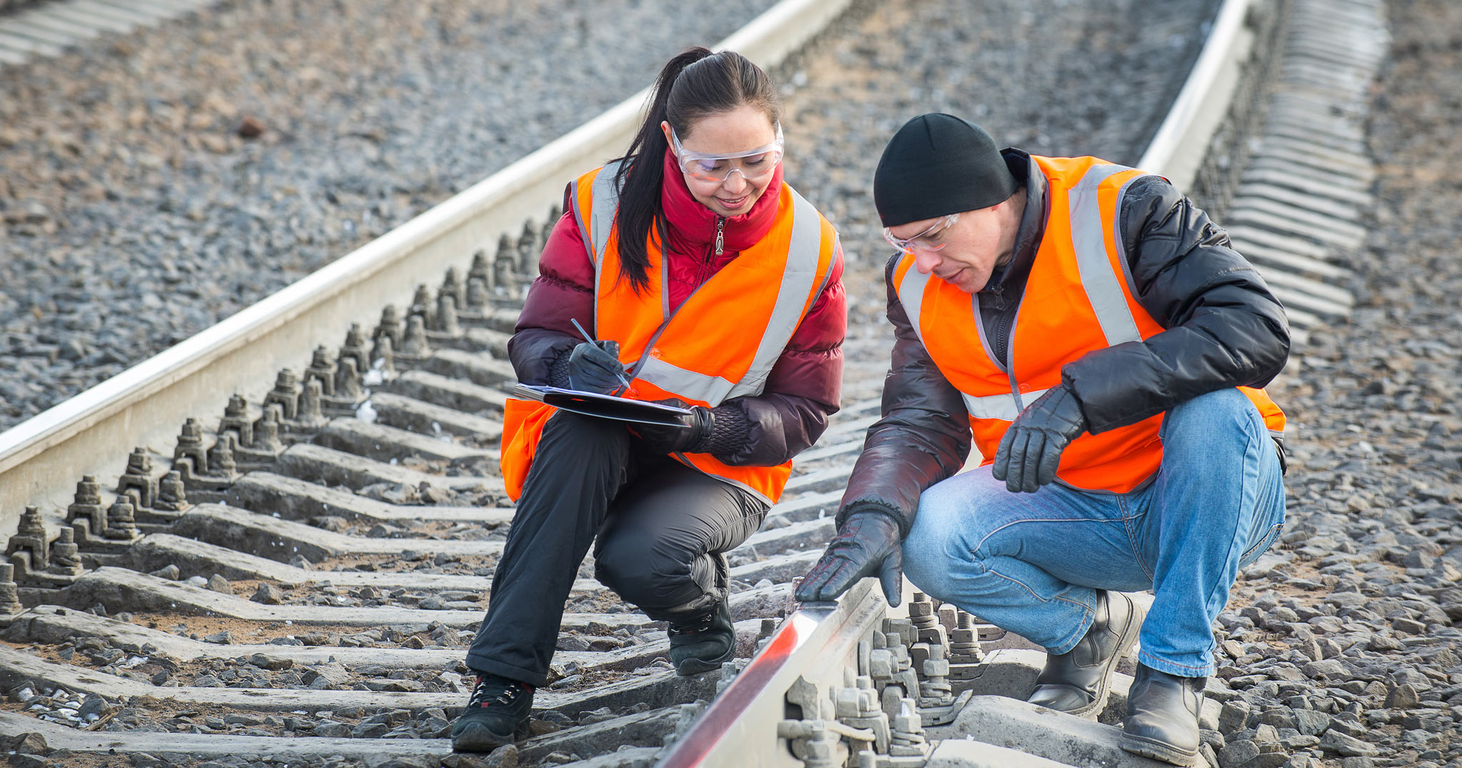 Workers inspecting railway tracks