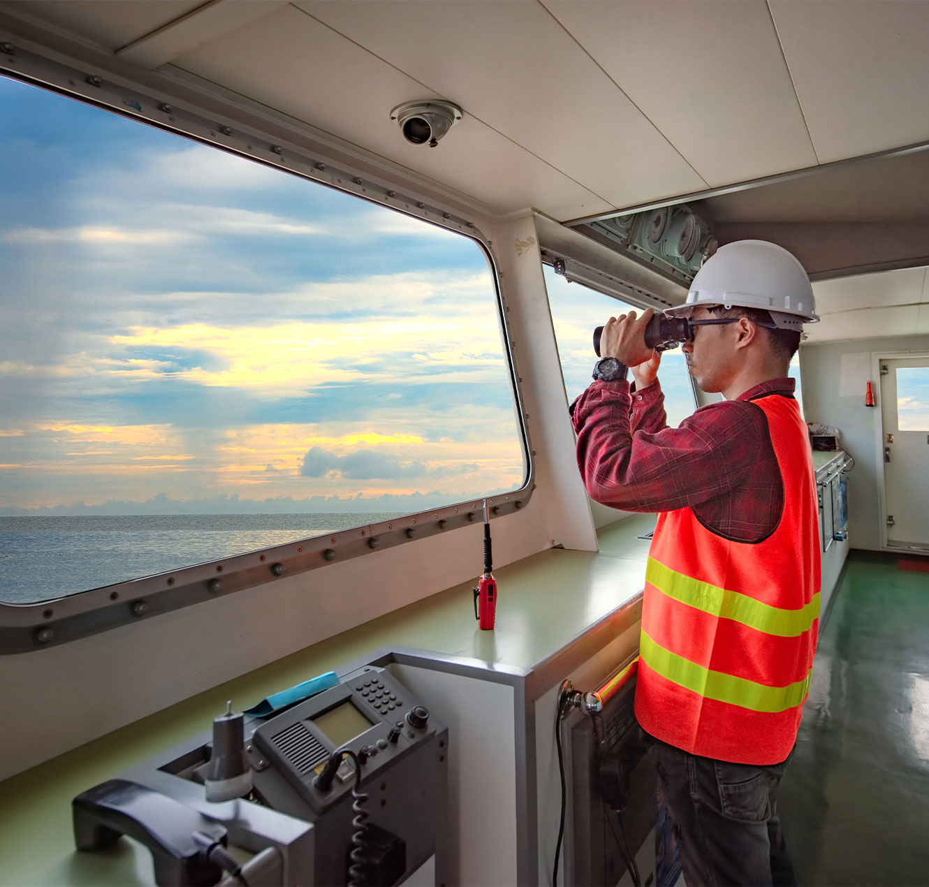 Officer in charge keeping an eye on ship navigation